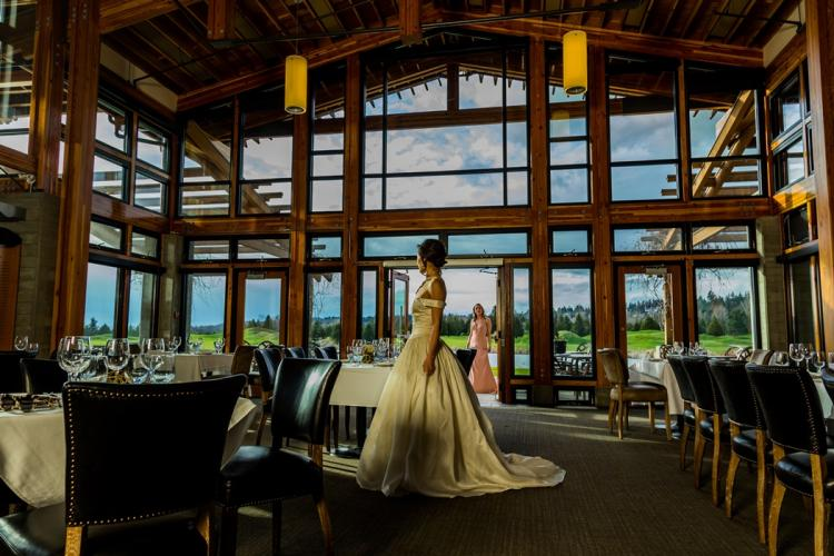 Photograph of a bride and bridesmaid in the Riverway Clubhouse