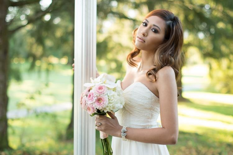 Bride poses by a lamp post on the lawns of the Burnaby Mountain Golfcourse